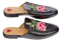 A pair of Gucci Women's Princetown leather slippers, designed in black leather, with horse bit