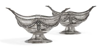 A pair of pierced silver oval baskets, London c.1891 and c.1900, C.S Harris & Sons, each of