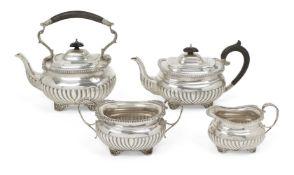 A matched silver four-piece tea service, the teapot and tea kettle Birmingham, c.1910, SW Smith
