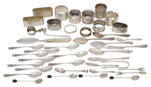 A group of small silver including: nine silver napkin rings, a set of ten coffee spoons with