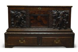 A Continental oak and inlaid coffer, 18th Century, the hinged lid enclosing storage space, the
