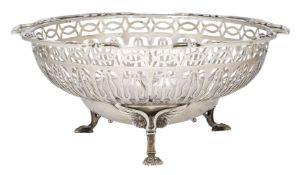A George V pierced silver bonbon dish, Sheffield, c.1912, Walker and Hall, raised on three claw feet