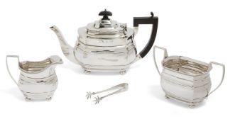A George V three-piece silver tea set, Birmingham, c.1927, Blanckensee & Son Ltd, of rectangular