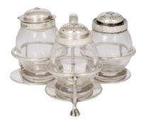 A trefoil silver-topped glass cruet set, Sheffield, c.1917, The Goldsmiths & Silversmiths Company,