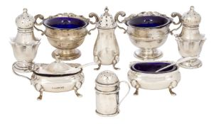 A collection of small silver cruets comprising a pair of star baluster shaped peppers, Birmingham,