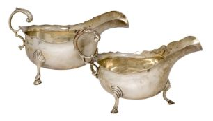 Two silver sauce boats, the larger example Birmingham, c.1911, Williams Ltd., raised on three