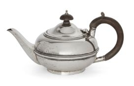A small silver teapot, London, c.1922, Charles Boyton & Son Ltd, of globular form with two reeded