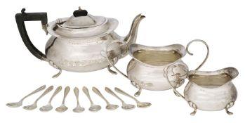 A three-piece silver tea set, Birmingham, c.1922, F. H. Adams & Cote, comprising a teapot, sugar