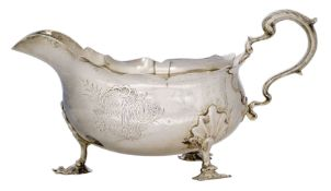 An Edwardian silver sauce boat, Birmingham, c.1908, B&L, the body with engraved armorial raised on