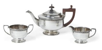 A late George V silver three-piece tea set, Birmingham, c.1933, JW Tiptaft & Son, comprising a tea