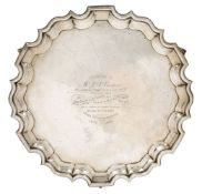 A presentation silver salver, Chester, c.1924, Barker Brothers, with shaped pie crust rim to