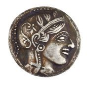 An ancient Greek Attica, Athens silver tetradracham, the obverse with helmeted head of Athena facing