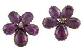 A pair of Georgian gilt metal foiled purple paste earclips, of flowerhead cluster design, each