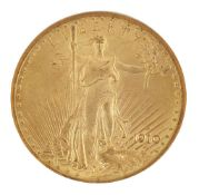 A USA gold $20 coin, 1910, in slab case from the Numismatic Guaranty Corporation of AmericaPlease