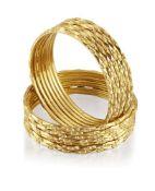 Fourteen bangles, of matching geometric hoop design, internal diam. 5.6cmapprox. total weight 164.0g