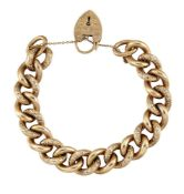 A 9ct gold bracelet, of curb link design, alternate links with scroll decoration to a padlock clasp,