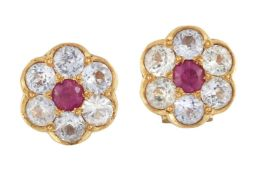 A pair of synthetic ruby and colourless gem earrings, of flowerhead cluster design, each circular
