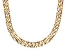 A flexible necklace, of fancy link design with a central line of flowerhead motifs and bead borders,