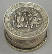 A Chinese balm box decorated with figures