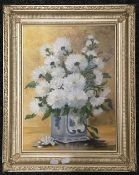 JOAN CAWLEY (20th century) British, Floral Still Lifes, oil on board, signed, framed, a pair.