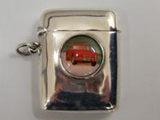 A silver vesta depicting a car