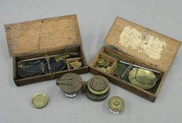 A set of bronze cup weights and other various weights and scales