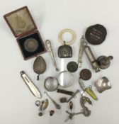 A quantity of small silver and other novelty items