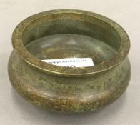 A small Chinese bronze censer. 8 cm diameter, 4 cm high.