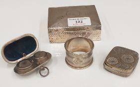 A silver cigarette box,
