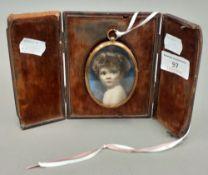 A cased miniature portrait of a child