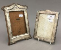 Two silver photograph frames