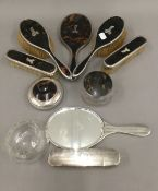 A quantity of silver and tortoiseshell mounted dressing table items