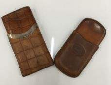 A silver mounted crocodile skin cigar case and a leather cigar case