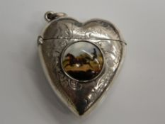 A silver vesta formed as a heart