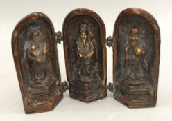 A bronze triptych shrine