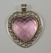 A silver heart shaped pendant