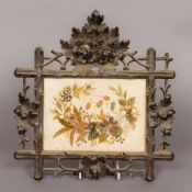 A 19th century needlework panel on silk, of foliate form,