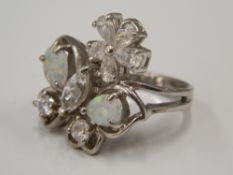 A silver opal and cubic zirconia ring