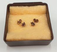 A pair of garnet set earrings