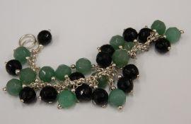 A jade and black set silver bracelet
