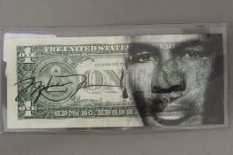 A Mike Tyson signed one dollar note