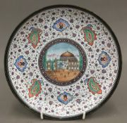 A Persian enamel decorated dish