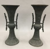 A pair of 19th century Chinese bronze vases