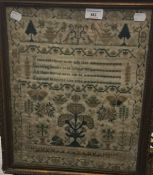 A 19th century sampler worked with a verse, trees and butterflies, etc.