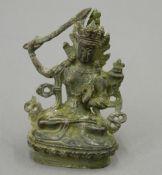 A small bronze model of Buddha