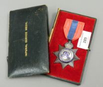 A cased Imperial Service medal