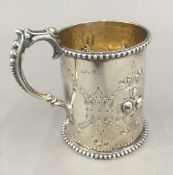 An embossed silver Christening mug (5.