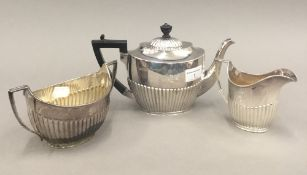 A silver three-piece tea set (28.