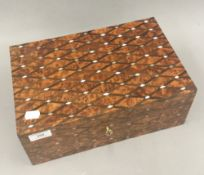 A mother-of-pearl inlaid burrwood box