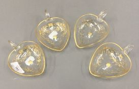 Four 19th century gilt decorated heart shaped glass tasting vessels